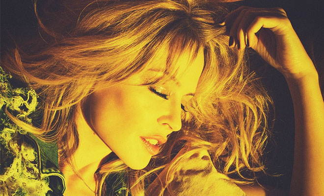 "Kylie Minogue Takes Us Behind The Scenes Of Her Latest Music Video ""Dancing"""