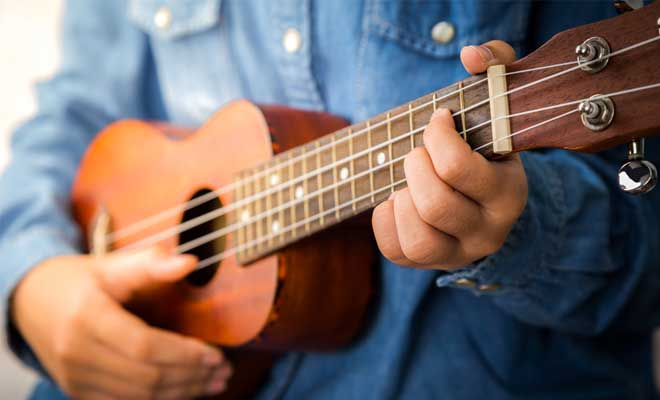 Get to know how to hold the ukulele
